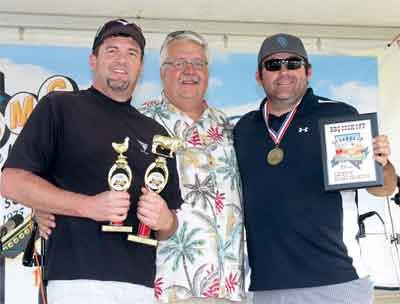 Local barbecue team Smokin' and Jokin' won the Reserve Champion award at the Fall Festival BBQ Competition. Pictured here l to r Don Adams Jr., festival organizer Rik Eide and Kyle Heiselbetz.  PHOTO BY MAGGIE MCMURRAY/Moapa Valley Progress.