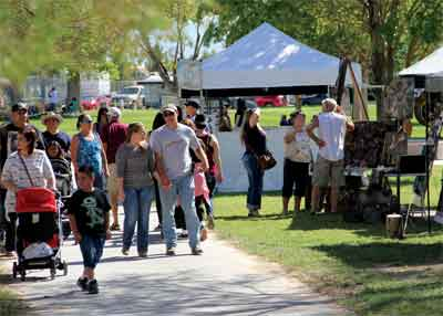 Crowds at the Logandale Fall Festival walk through a myriad of vendors on Saturday afternoon. PHOTO BY VERNON ROBISON/Moapa Valley Progress.