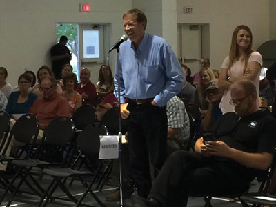 Logandale resident Lindsey Dalley makes comments to the panel during a Town Hall meeting held on Thursday night regarding reorganization of the CCSD. Pictured behind him in line to make comments is Mesquite resident Courtney Sweetin, a member of Break Free CCSD. PHOTO COURTESY OF ED GONZALEZ.