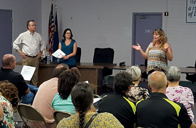 County Commissioner Marilyn Kirkpatrick speaks to a large audience at the Overton Community Center during a seminar held by County officials last week. Also pictured is Building Department Acting Director Sam Palmer (far left) and Department of Comprehensive Planning Manager Sami Real (middle). PHOTO BY VERNON ROBISON/Moapa Valley Progress.